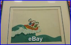 Disney production cel Huey, Dewey, and Louie surfing, framed